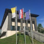 entrance with flags of the Vatican, Croatia and EU